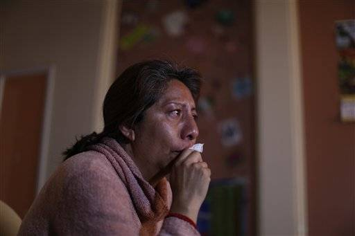 In this Jan. 25, 2016 photo, Guadalupe Reyes holds back her tears as she talks about her daughter Mariana Yanez, in Ecatepec, a rough neighborhood on the outskirts of Mexico City. On an otherwise normal evening in September 2014, Yanez left her home saying she was going to make some photocopies, and then vanished. Months later, authorities called her mother to say she was dead. Pope Francis will will hold the largest public event of his visit to Mexico in this neighborhood when he celebrates Mass on Feb. 14. (AP Photo/Dario Lopez-Mills)