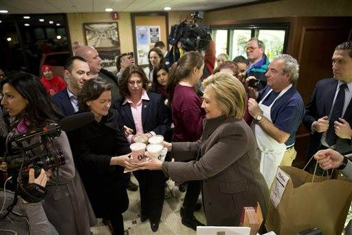Democratic presidential candidate Hillary Clinton hands off her food order Sunday, Feb. 7, 2016, at Puritan Backroom restaurant in Manchester, N.H. (AP Photo/Matt Rourke)