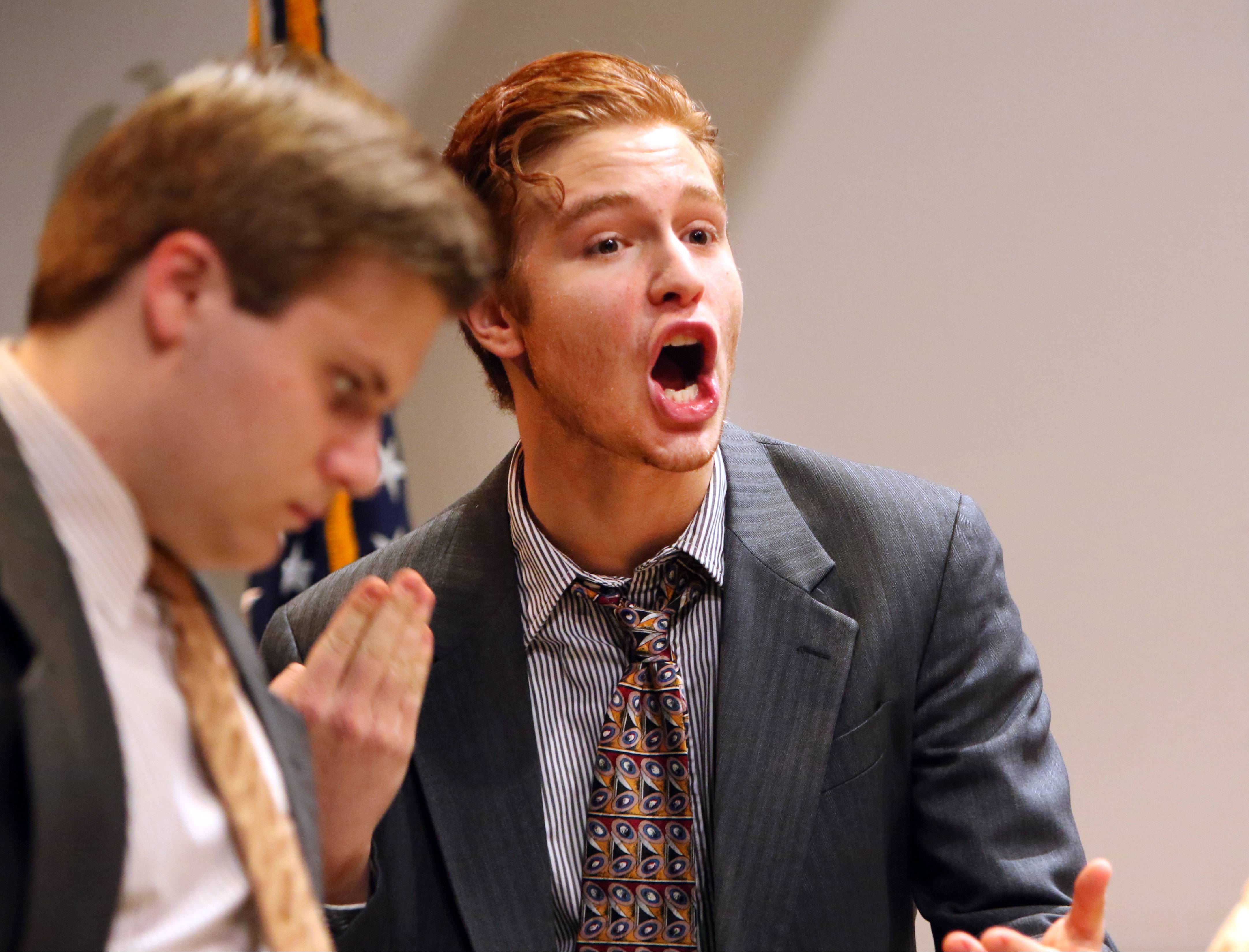 "Junior Adam Hamer, right, plays the role of Juror No. 3 during the Vernon Hills High School Backlight Theatre Company's dress rehearsal of ""Twelve Angry Jurors"" on Tuesday."