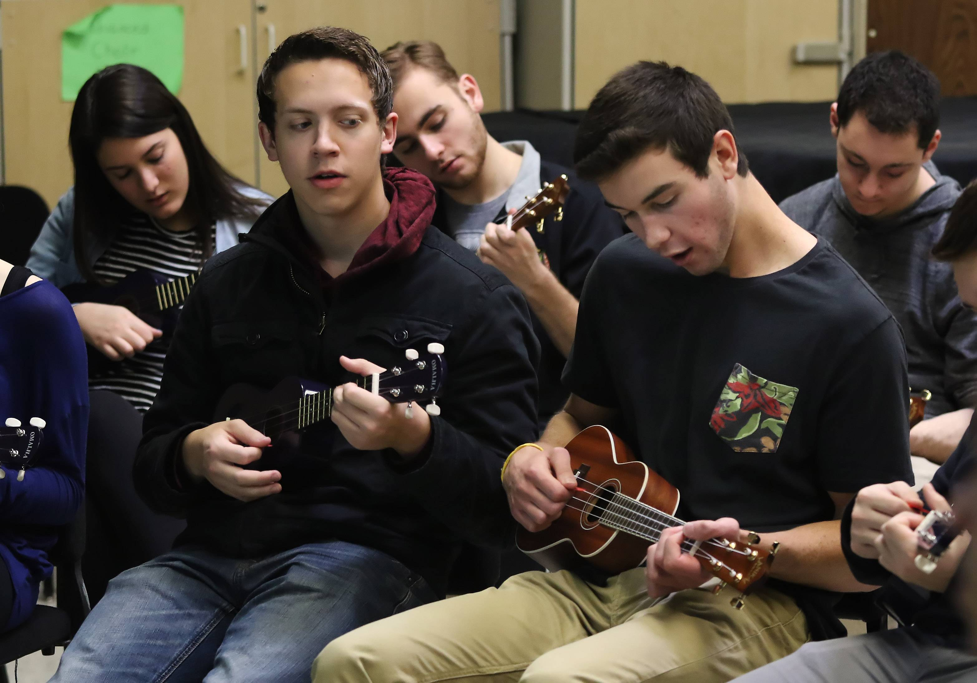 Stevenson High School students Michael Schodin, left, and Michael Manion learn to play ukuleles Tuesday during Odyssey 2016 at the Lincolnshire school. More than 160 visiting artists and 42 faculty instructed classes ranging from cake decorating, calligraphy and flower arranging to zumba and special effects make up.