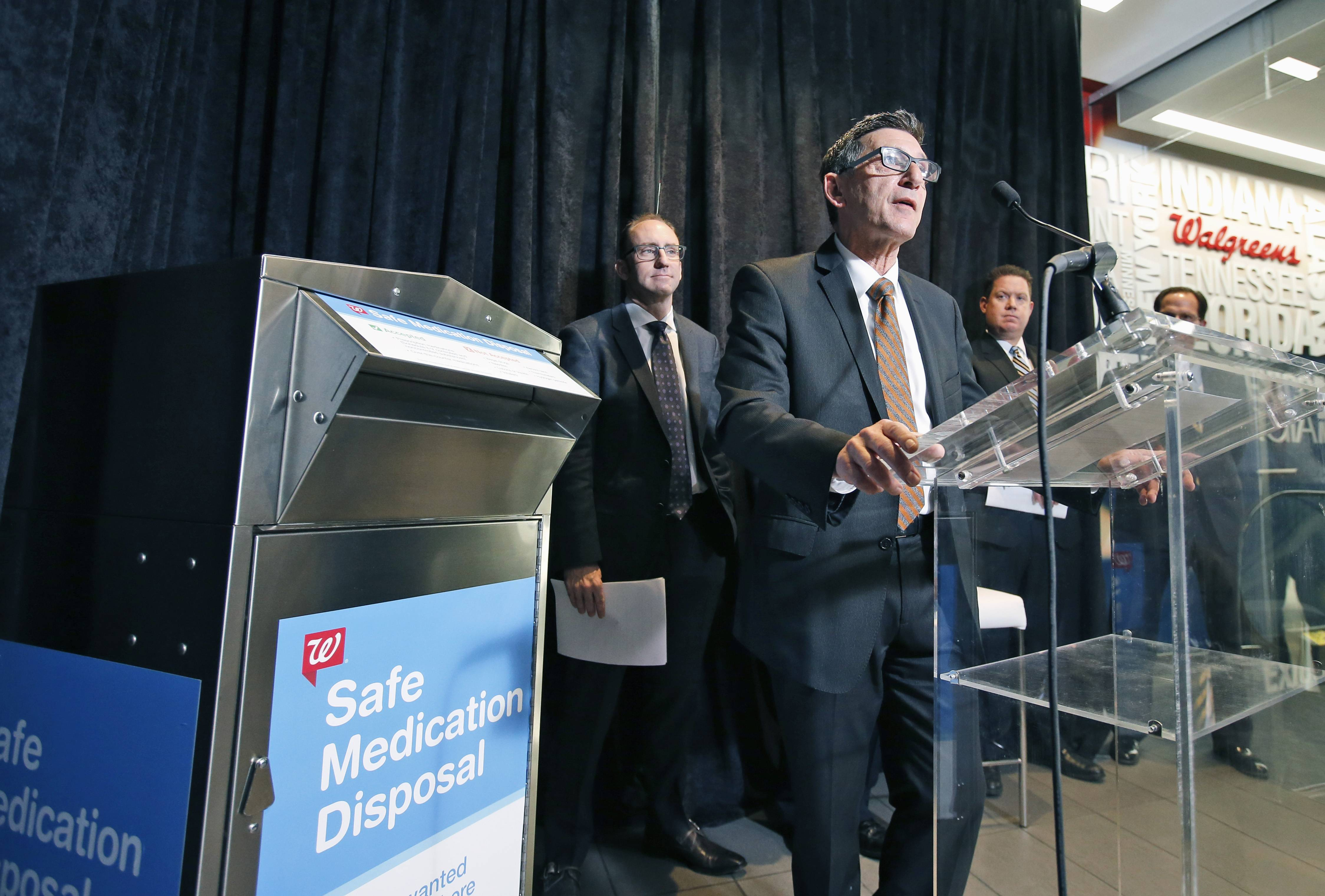 White House Drug Policy Director Michael Botticello, accompanied by Richard Ashworth, Walgreens president for pharmacy and retail operations, left, and Lake County State's Attorney Michael Nerheim speak on Capitol Hill about Walgreens' plans to make the heroin overdose antidote drug naloxone available without a prescription at pharmacies in 35 states, including Illinois.