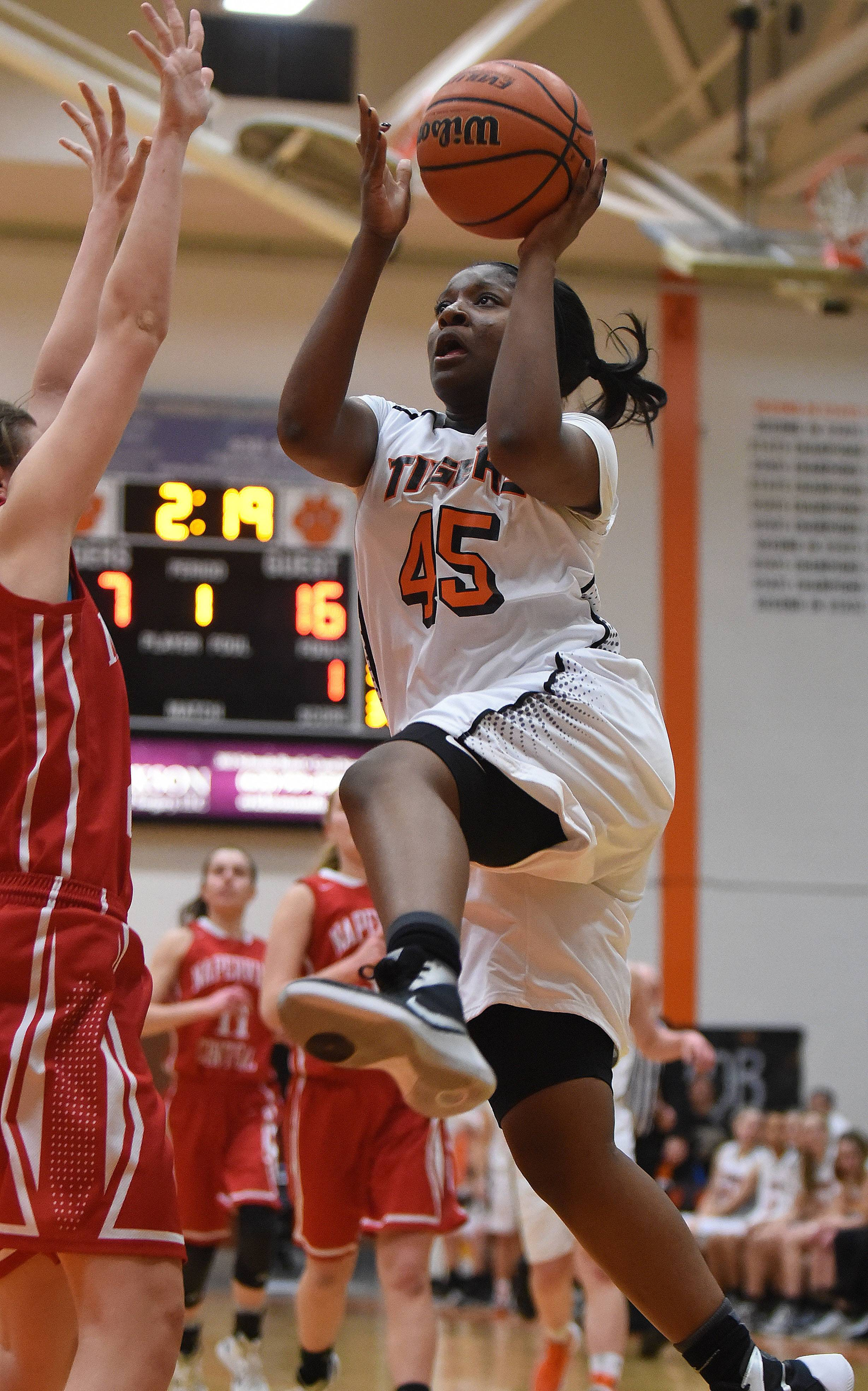 Jayla Johnson of Wheaton Warrenville takes the ball to the net.