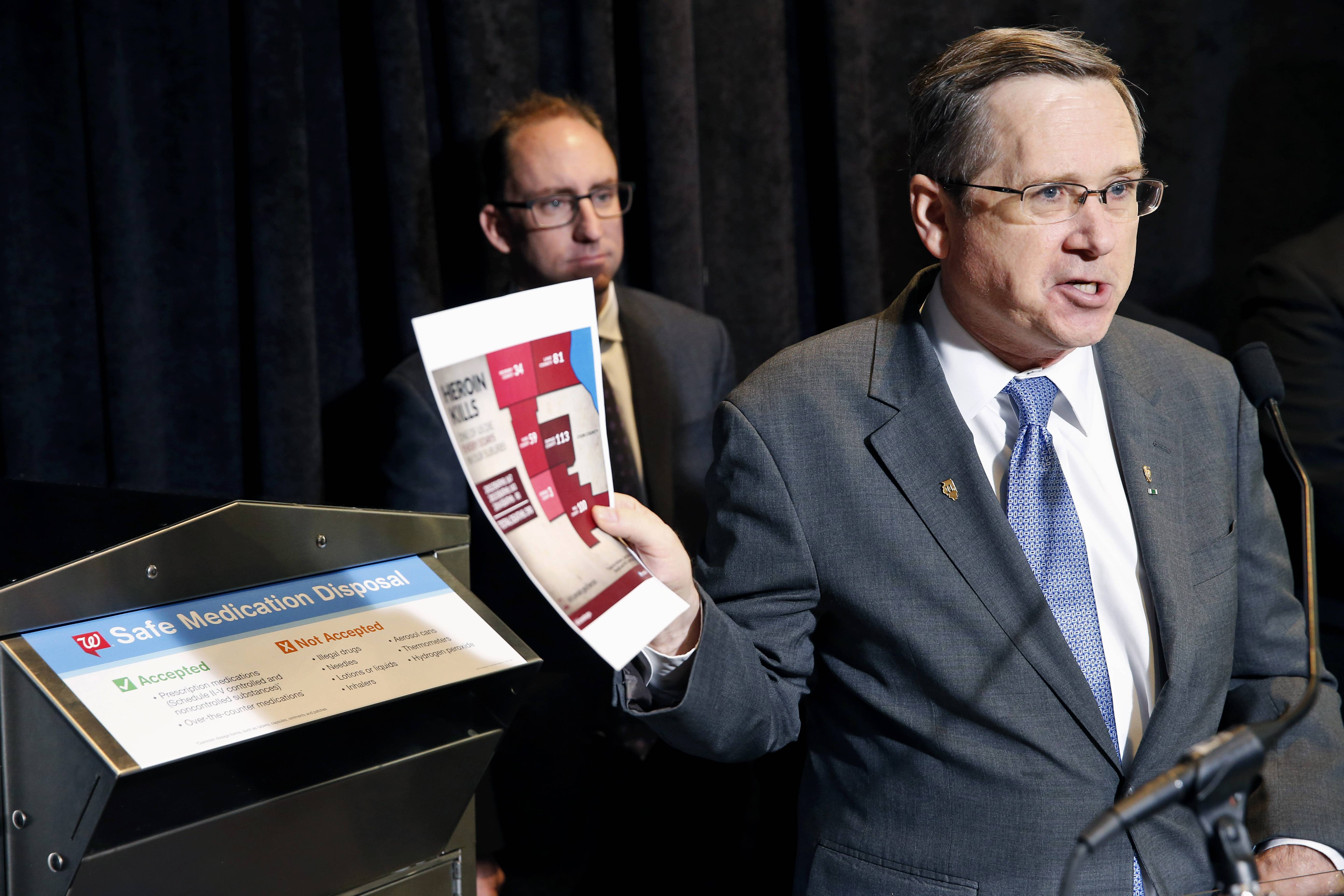Sen. Mark Kirk, right, accompanied by Richard Ashworth, Walgreens president for pharmacy and retail operations, speaks Tuesday during a news conference in Washington, D.C., to discuss plans to make the heroin overdose antidote drug naloxone available without a prescription.