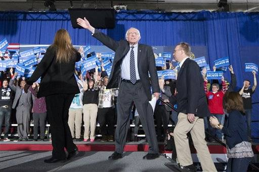 Democratic presidential candidate Sen. Bernie Sanders, I-Vt., waves to the crowd during a primary night watch party at Concord High School, Tuesday, Feb. 9, 2016, in Concord, N.H. (AP Photo/John Minchillo)