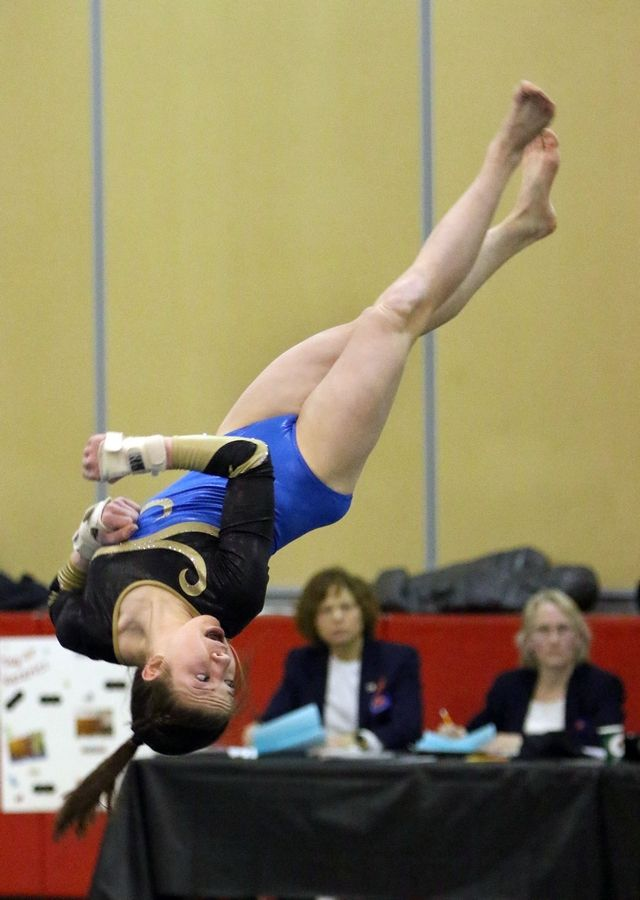Warren's Teagon Albert competes on the floor exercise during Tuesday's girls gymnastics sectional meet at Mundelein.