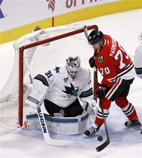 Chicago Blackhawks left wing Dennis Rasmussen (70) is unable to get a shot on San Jose Sharks goalie Martin Jones during the first period of an NHL hockey game Tuesday, Feb. 9, 2016, in Chicago. (AP Photo/Charles Rex Arbogast)