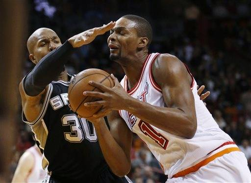 Miami Heat forward Chris Bosh (1) goes up for a shot against San Antonio Spurs forward David West (30) during the first half of an NBA basketball game, Tuesday, Feb. 9, 2016, in Miami. (AP Photo/Wilfredo Lee)
