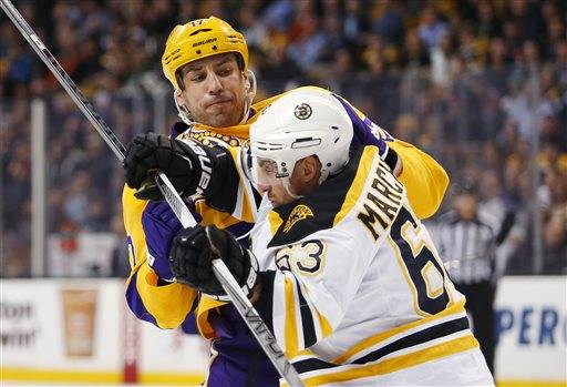 Los Angeles Kings' Milan Lucic collides with Boston Bruins' Brad Marchand (63) during the first period of an NHL hockey game in Boston Tuesday, Feb. 9, 2016. (AP Photo/Winslow Townson)