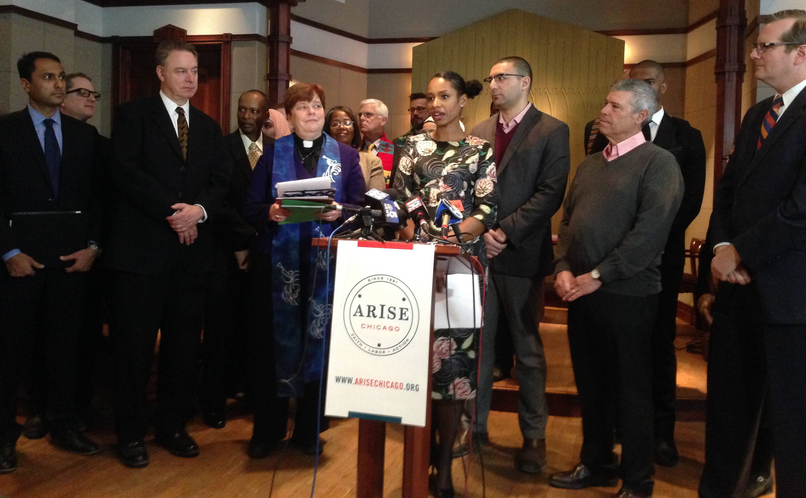 Former Wheaton College professor Larycia Hawkins, officials from Wheaton College and supporters speak at a news conference Wednesday in Chicago. The school announced it is creating an endowed scholarship in her name.