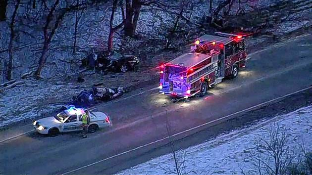 Golf Road near Hoffman Estates was closed Wednesday morning after a car crashed into a ditch and struck a tree, causing the vehicle to split in two. The 47-year-old Streamwood woman driving the car was hospitalized.