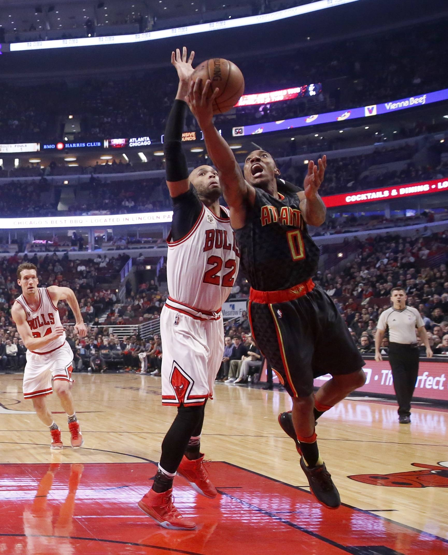 Atlanta Hawks guard Jeff Teague (0) drives past Chicago Bulls forward Taj Gibson during the first half of an NBA basketball game Wednesday, Feb. 10, 2016, in Chicago. (AP Photo/Charles Rex Arbogast)