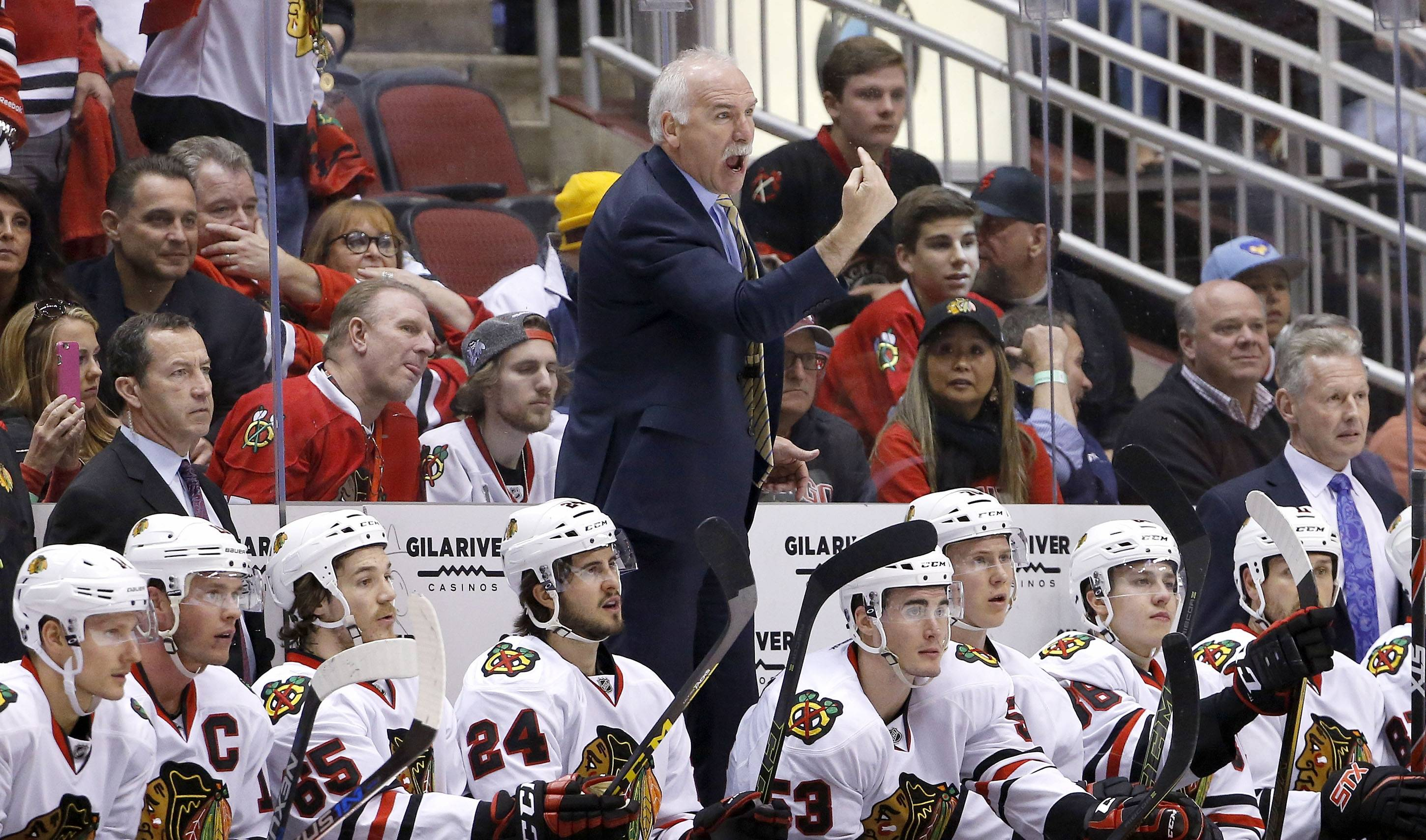 Chicago Blackhawks' Joel Quenneville stands on the team bench as he argues with officials during the first period of an NHL hockey game against the Arizona Coyotes Thursday, Feb. 4, 2016, in Glendale, Ariz. (AP Photo/Ross D. Franklin)