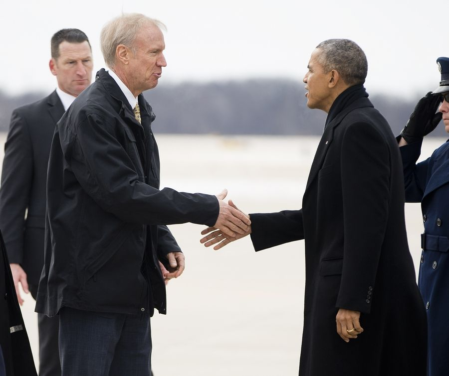 President Barack Obama is greeted by Illinois Gov. Bruce Rauner during his arrival Wednesday on Air Force One at Abraham Lincoln Capitol Airport in Springfield.