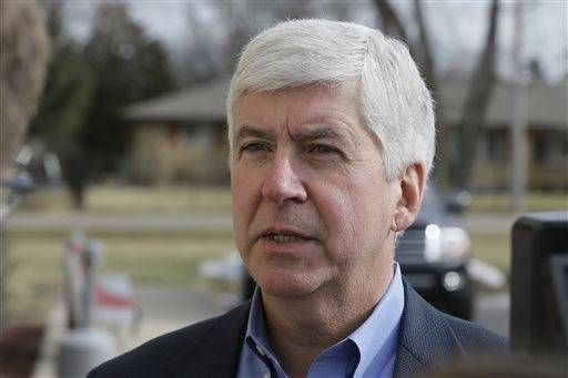 FILE-- In this Friday, Feb. 5, 2016 file photo, Michigan Gov. Rick Snyder is interviewed after visited a church that's distributing water and filters to its predominantly Latino parishioners in Flint, Mich. Snyder will propose spending $195 million more to address Flint's water crisis and another $165 million updating infrastructure across the state in response to lead contamination overwhelming the city. The plan will be detailed in the Republican governor's annual $54.9 billion budget presentation to the GOP-led Legislature on Wednesday, Feb. 10, 2016. (AP Photo/Carlos Osorio, File)