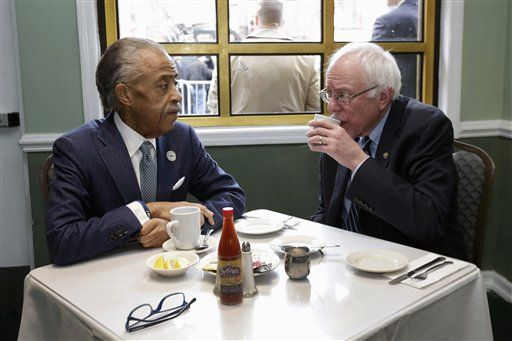 The Rev. Al Sharpton talks with Democratic presidential candidate Sen. Bernie Sanders, I-Vt. as they sit down for a breakfast meeting at Sylvia's Restaurant, Wednesday, Feb. 10, 2016, in the Harlem neighborhood of New York. Sanders defeated former Secretary of State Hillary Clinton on Tuesday in the New Hampshire primary.