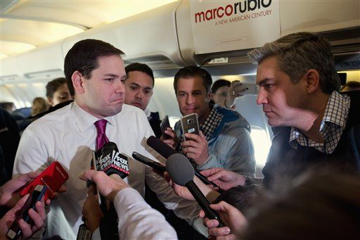 Republican presidential candidate, Sen. Marco Rubio, R-Fla. speaks to members of the traveling media on board his plane en route from New Hampshire to South Carolina, Wednesday Feb. 10, 2016, after the New Hampshire primary.