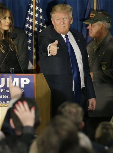 Republican presidential candidate, businessman Donald Trump gives a thumbs up to supporters during a primary night rally, Tuesday, Feb. 9, 2016, in Manchester, N.H.