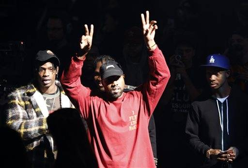 "Kanye West gestures to the audience at the unveiling of the Yeezy collection and album release for his latest album, ""The Life of Pablo,"" Thursday, Feb. 11, at Madison Square Garden in New York."