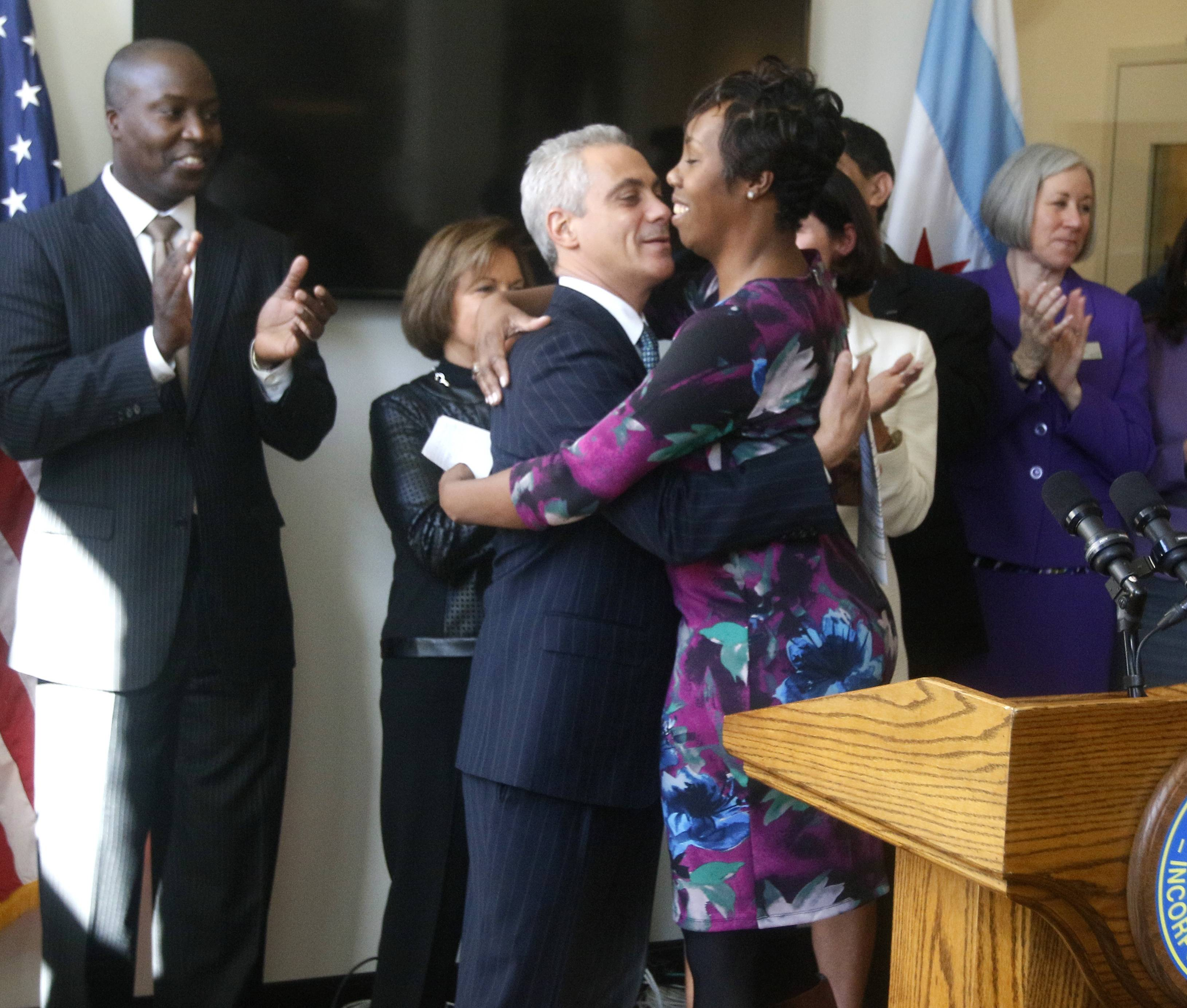Mayor Rahm Emanuel hugs VersAnnnette Blackman-Bosia, a WINGS graduate and advocate, during a news conference Thursday announcing the opening of the new South Side shelter.