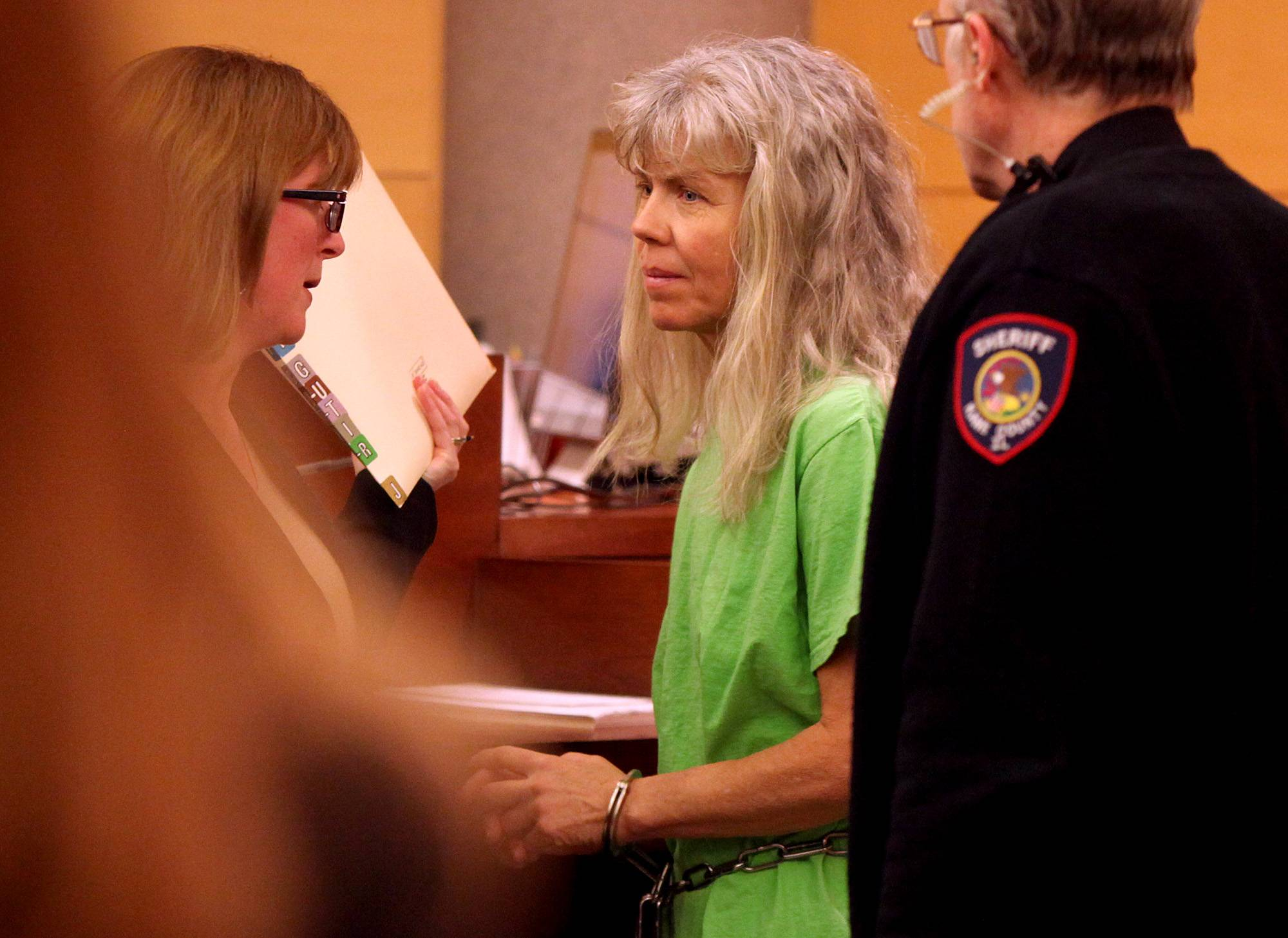 Julia Gutierrez converses Thursday with Kane County Assistant Public Defender Julie Yetter at the Kane County Judicial Center. Gutierrez, 53, of Geneva, faces two counts of first-degree murder in the death of her husband, Eduardo Gutierrez.