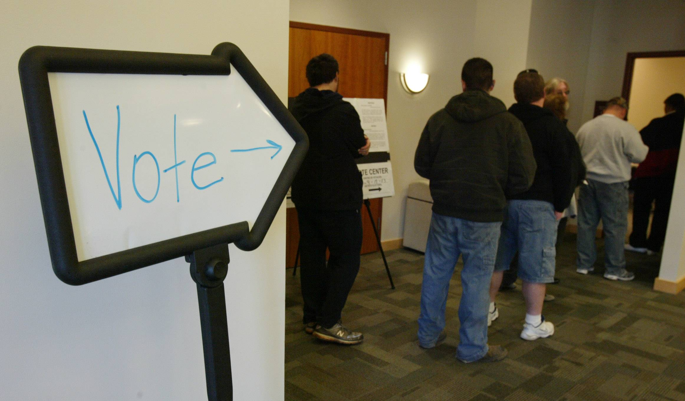 Elgin residents wait to vote at the Gail Borden Public Library in 2010. This year's primary isn't for a month, but people can start voting in some places now.