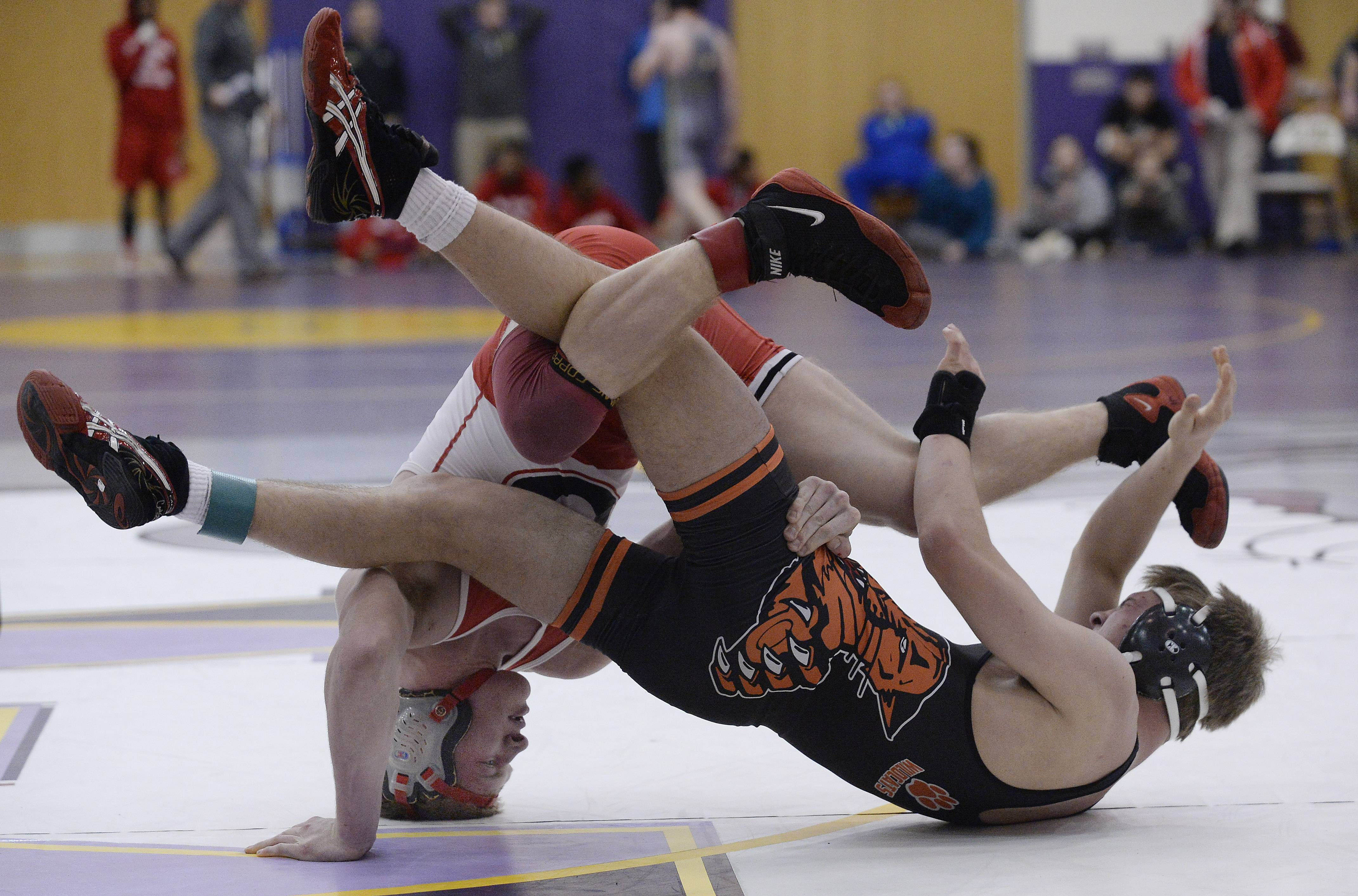 Grant's Cole Berg battles Will Johnson of Libertyville at 145 pounds in the championship match of North Suburban Conference tournament in Wauconda.