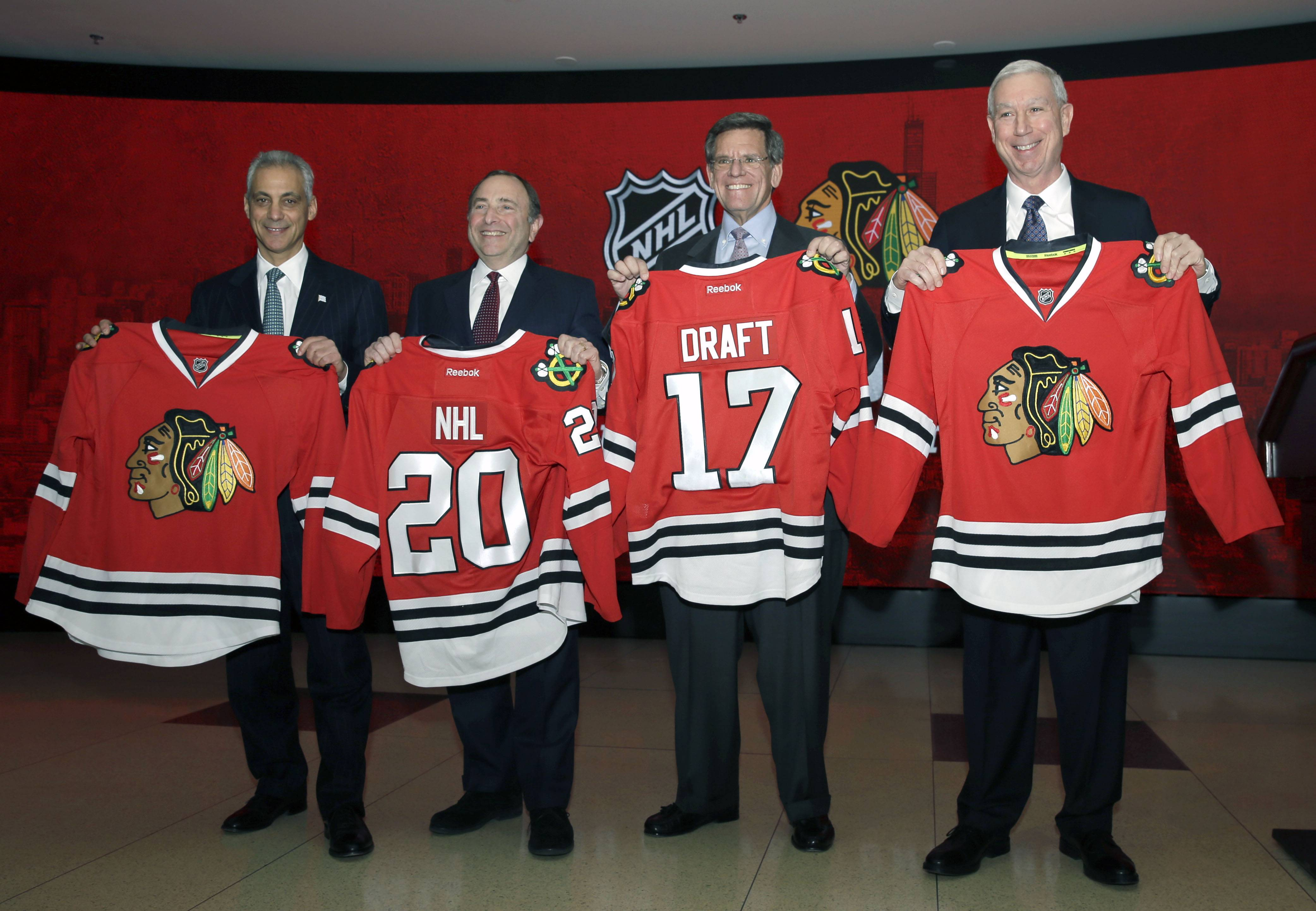 Left to right, Chicago Mayor Rahm Emanuel, NHL Commissioner Gary Bettman, Chicago Blackhawks Chairman Rocky Wirtz and Chicago Blackhawks President John McDonough hold jerseys during a special announcement by the NHL at a news conference Thursday, Feb. 11, 2016, in Chicago. The Chicago Blackhawks will host the 2017 NHL Draft at United Center. The Draft will be held over two days, Friday, June 23, and Saturday, June 24, 2017.