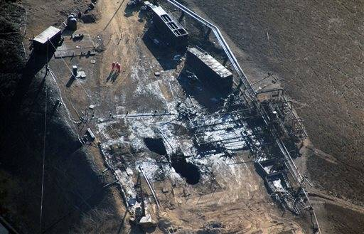 FILE - This Dec. 17, 2015 file photo provided by Earthworks shows an overhead aerial view of the relief well at the Aliso Canyon facility above the Porter Ranch area of Los Angeles. The utility says it has stopped the natural gas leak near Los Angeles after nearly 4 months. (Pete Dronkers/Earthworks via AP,File)