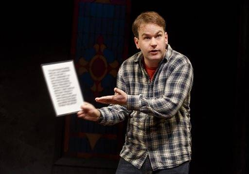 "In this image released by Joan Marcus, Mike Birbiglia appears during a performance of his new stage comedy ""Thank God for Jokes,"" in New York. (Joan Marcus via AP)"