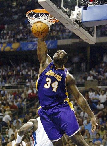 FILE - In this June 15, 2004, file photo, Los Angeles Lakers Shaquille O'Neal (34) dunks the ball against the Detroit Pistons in Game 5 of the NBA Finals in Auburn Hills, Mich.� This year's Hall of Fame class includes a star-studded field of potential finalists, including Shaquille O'Neal, Yao Ming and Allen Iverson. That trio should be a lock to get in. (AP Photo/ Michael Conroy, File)