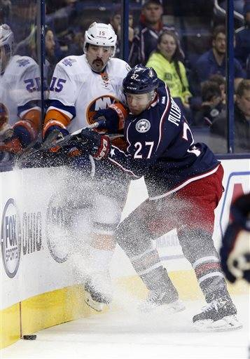 Columbus Blue Jackets' Ryan Murray, right, checks New York Islanders' Cal Clutterbuck during the first period of an NHL hockey game Tuesday, Feb. 9, 2016, in Columbus, Ohio. (AP Photo/Jay LaPrete)