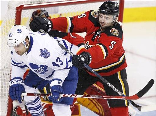 Toronto Maple Leafs' Nazem Kadri, left is pushed away from the Calgary net by Calgary Flames' Mark Giordano during second period NHL action in Calgary, Alberta, Tuesday, Feb. 9, 2016. (Larry MacDougal/The Canadian Press via AP) MANDATORY CREDIT