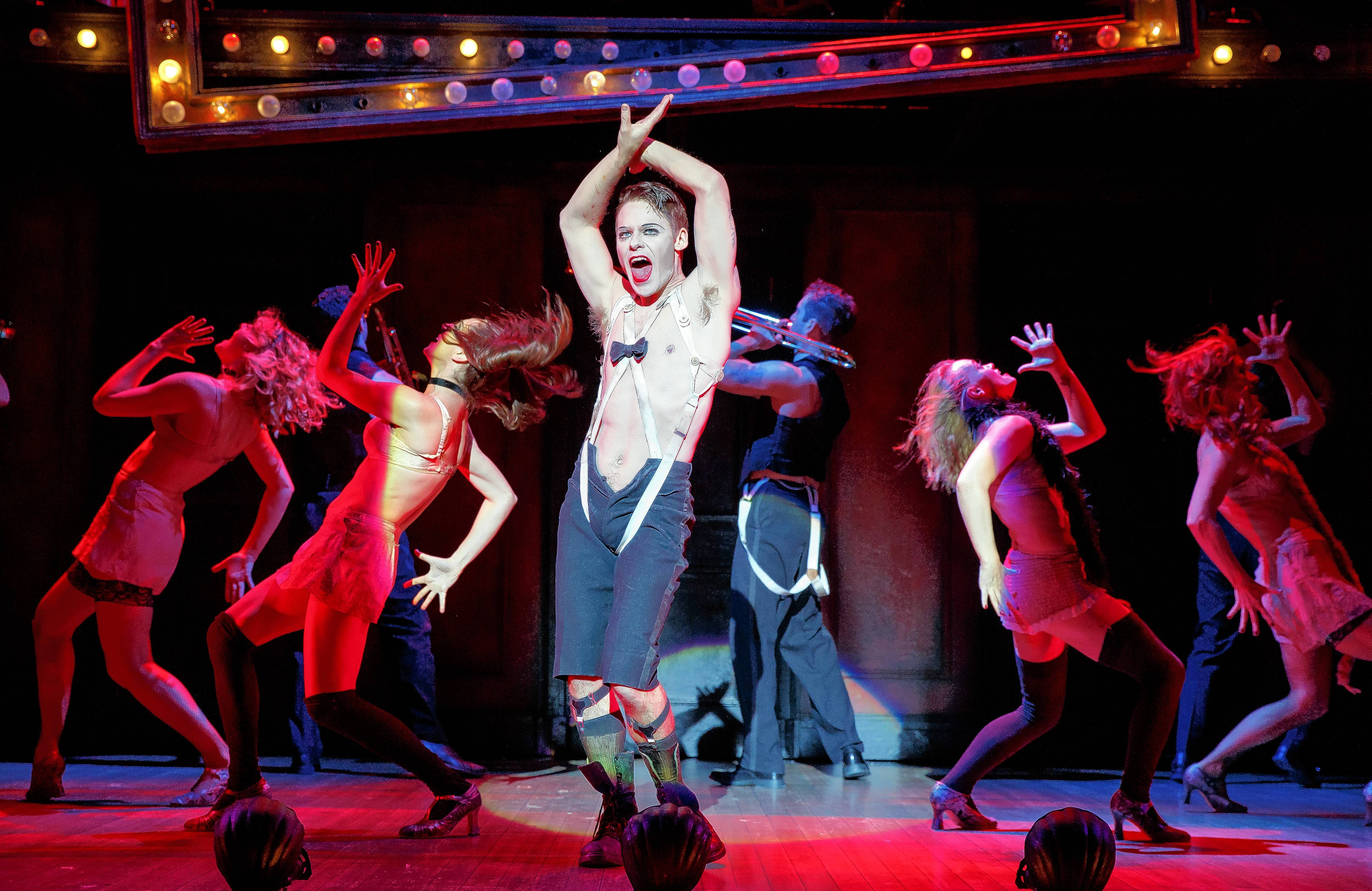 "The Emcee (Randy Harrison) performs with the ensemble of the Kit Kat Klub in the national tour of ""Cabaret."" The Tony Award-winning Roundabout Theatre Company Broadway revival tours to the The PrivateBank Theatre in Chicago."
