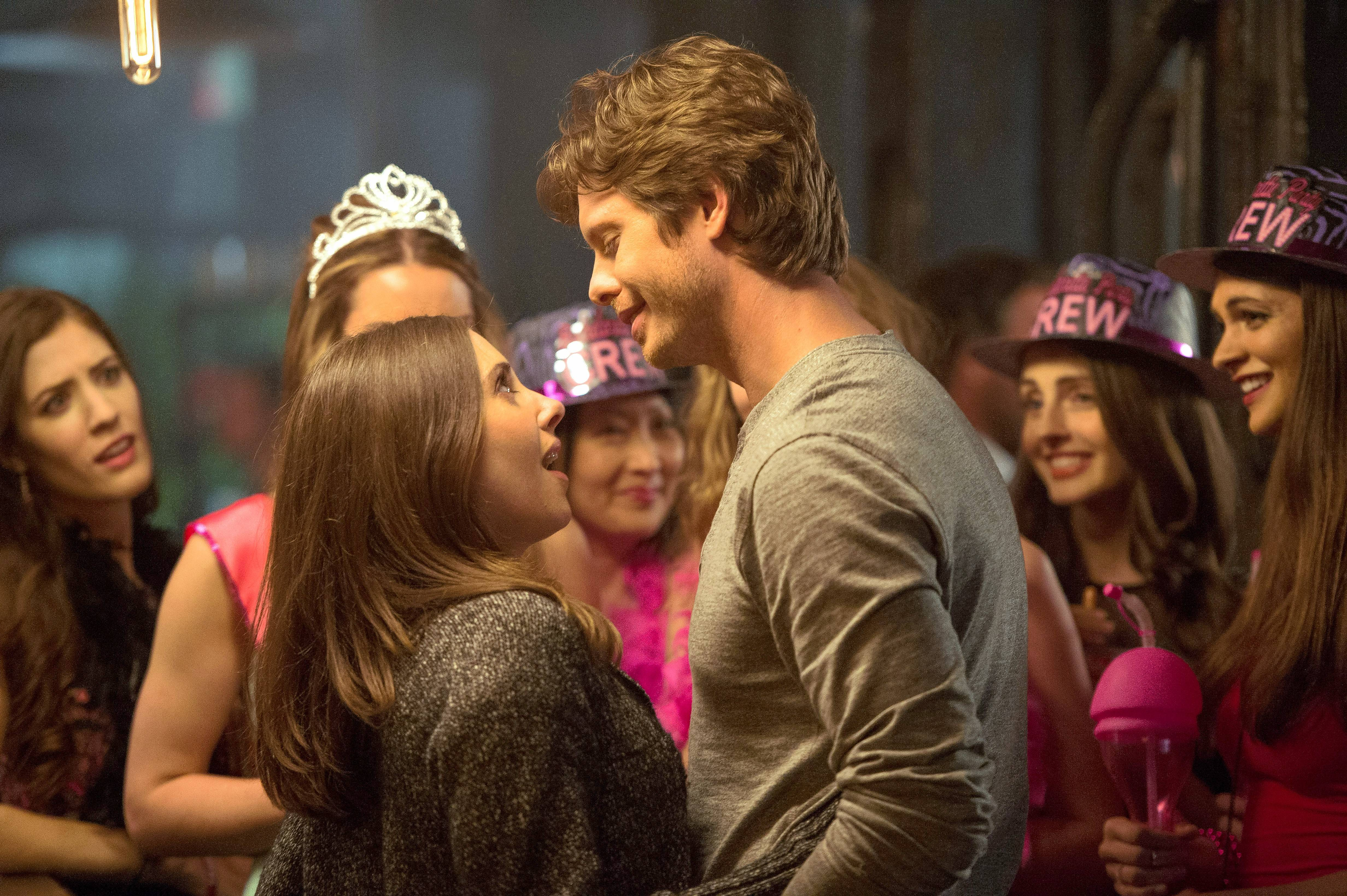 "Lucy (Alison Brie) gets a surprise from Tom the bartender (Anders Holm) in the ridiculously overwritten romantic comedy ""How to Be Single."""