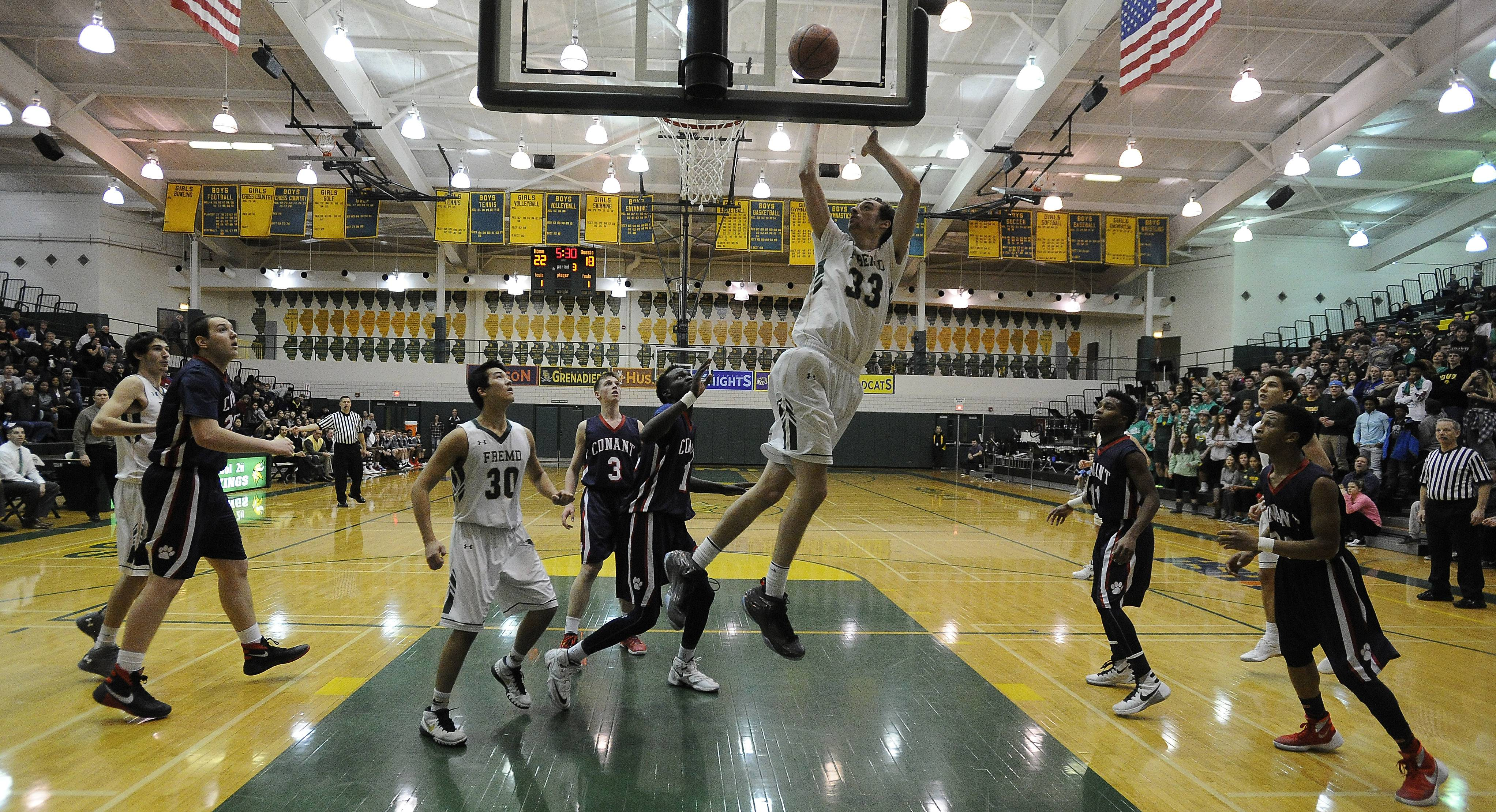 Fremd's Patrick Benka delivers two against Conant's defense in boys varsity basketball at Fremd on Friday.