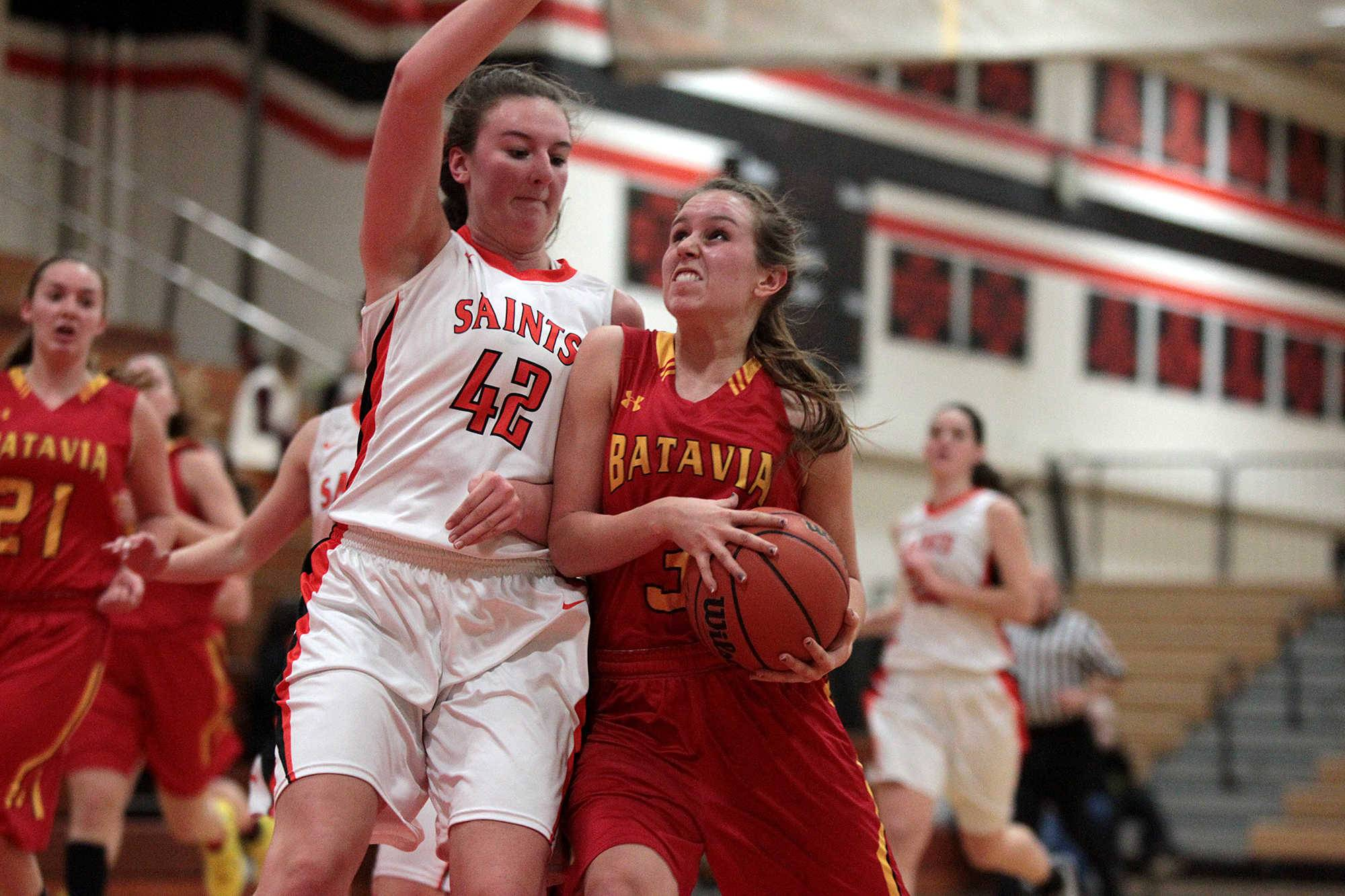Batavia's Bethany Orman , right, battles St. Charles East's Kathleen Townsend on her way to the basket earlier this season.