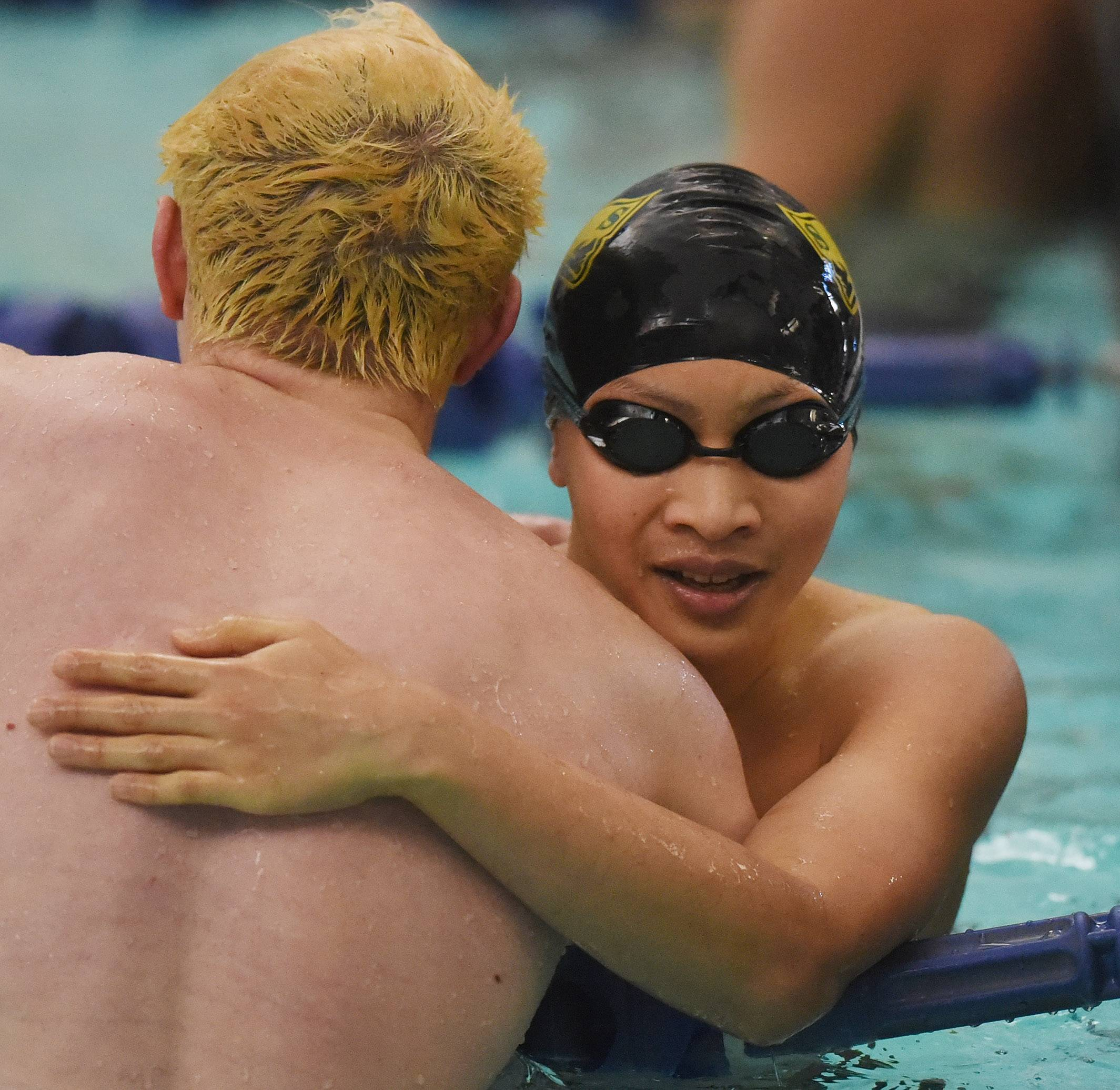 Event winner Daniel Ng of Stevenson, right, and Noah Jamieson of Libertyville congratulate one another at the conclusion of the 200-yard IM during the North Suburban Conference meet at Vernon Hills High School on Saturday.