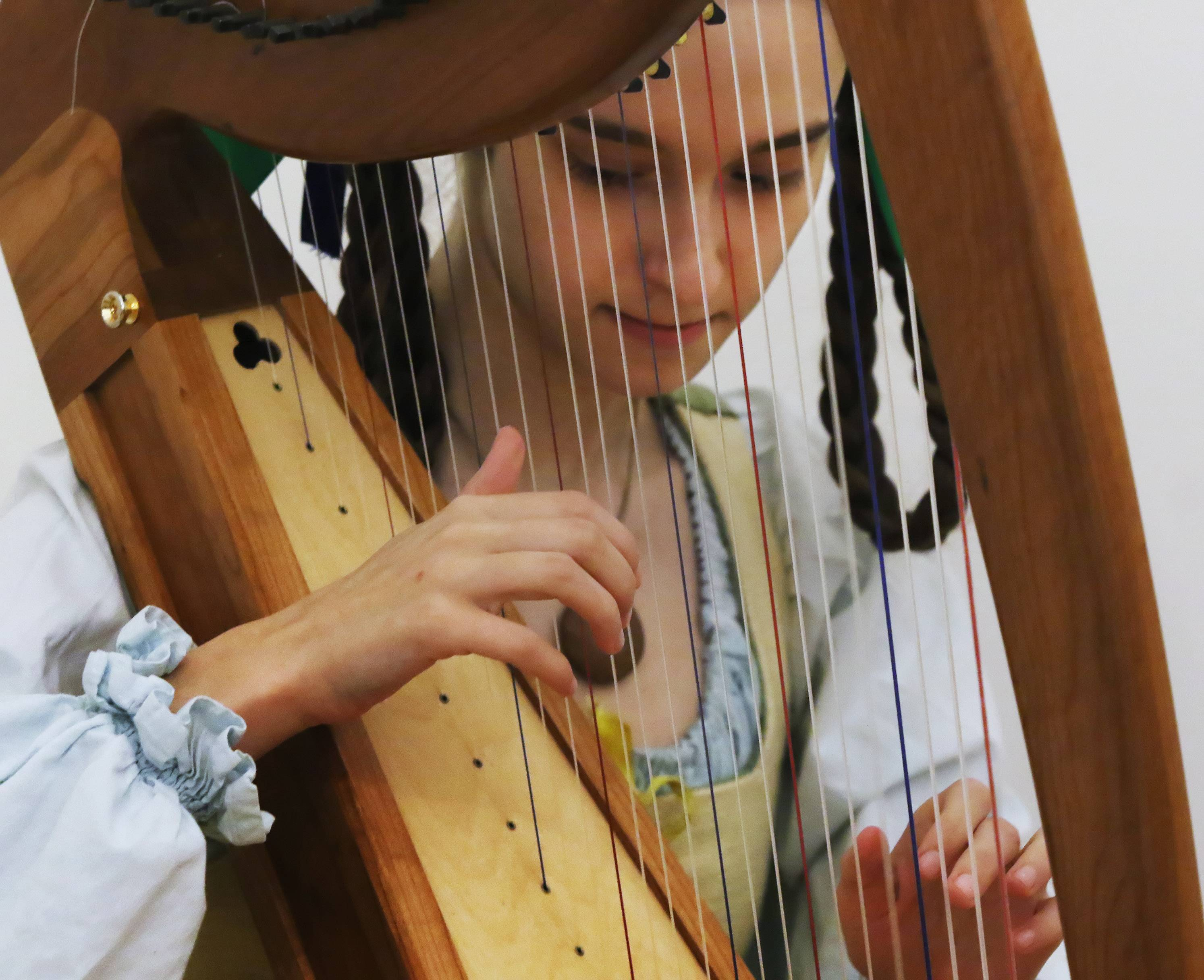Elizabeth Bolthouse of Palatine plays the harp during the Elizabethan Faire on Sunday at the Lake County Discovery Museum near Wauconda. The museum worked with Bristol Renaissance Faire to celebrate the works of William Shakespeare and the 16th century England.