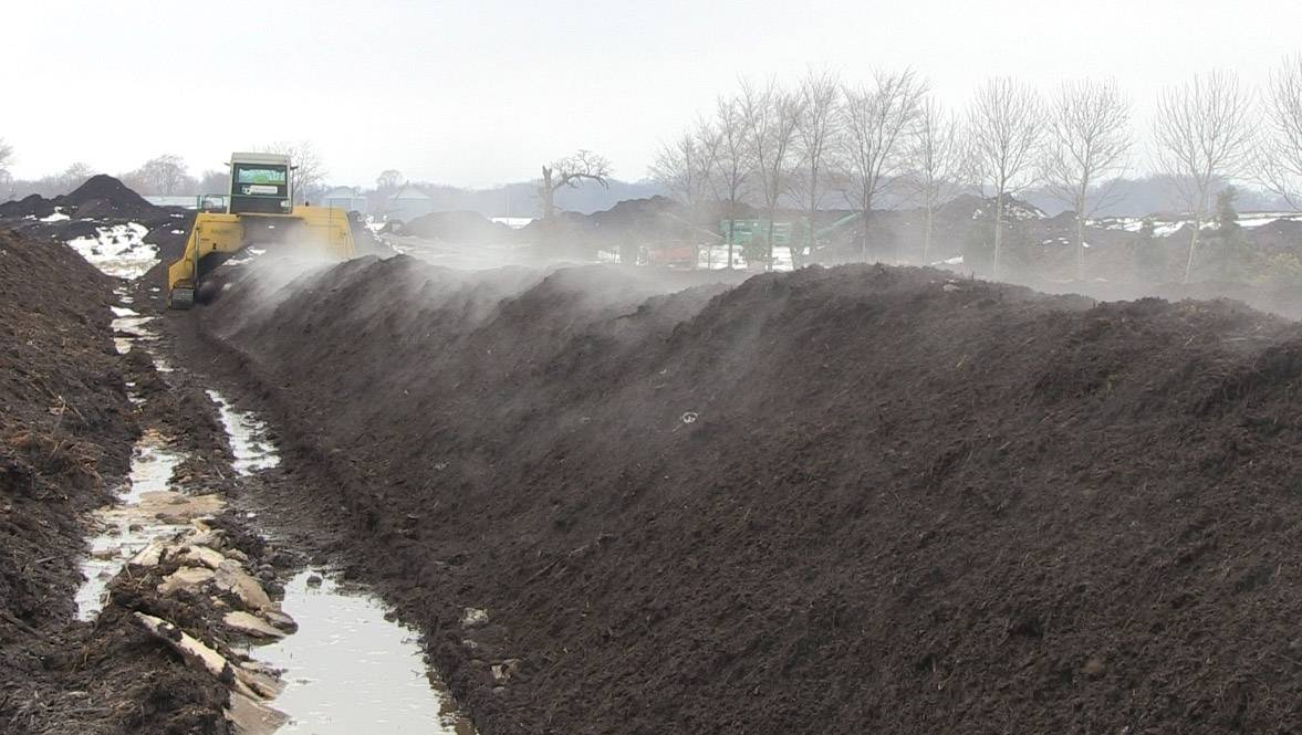 Steam rises from the dirt at Midwest Organics Recycling in Wauconda Township, where food scraps are turned into compost.