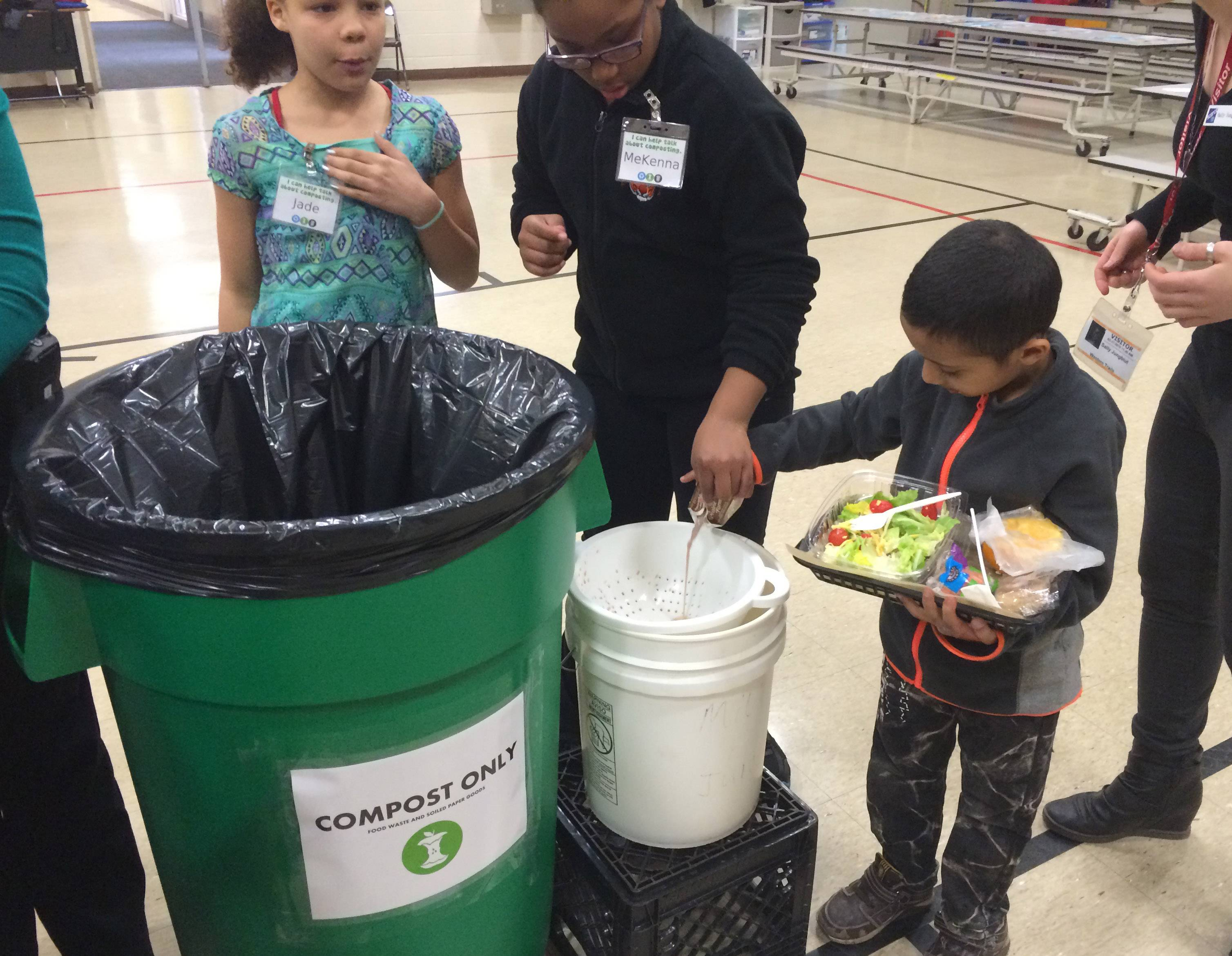 Students use food composting bins at Western Trails Elementary School in Carol Stream Elementary District 93.