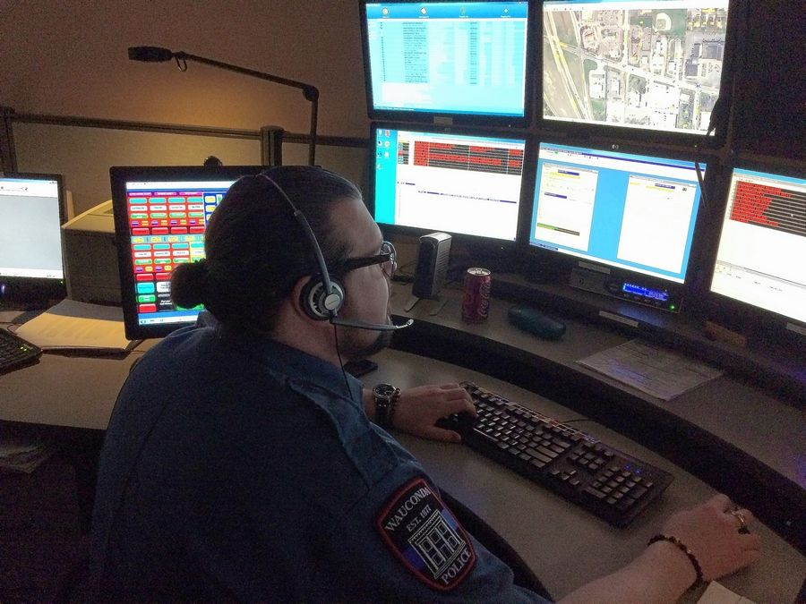 Wauconda dispatcher Joel Haerle handles a call. Village officials are planning to shut down the dispatch center at the police station and outsource the service to Lake Zurich.