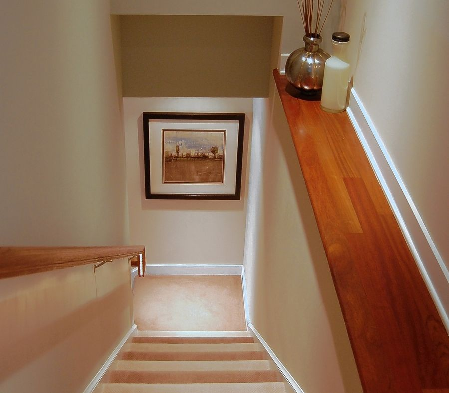 Lighting under the hand rail and carpeting with alternating color makes this staircase safer to traverse. The features are among those offered by New American Homes to make homes safer for residents as they age.