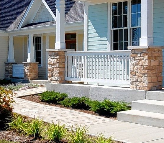 A sloped front porch is designed to provide a ramp for wheel-chair accessibility without being obvious. The feature is offered at Newport Cove in Antioch in homes built by New American Homes.