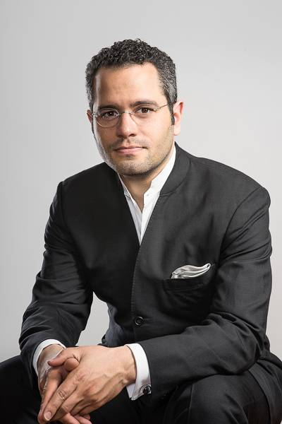Music Director Andrew Grams will conduct the Elgin Symphony Orchestra in a program featuring works by Johannes Brahms and Charles Ives on March 12-13.