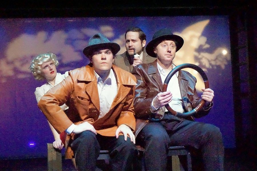 "A pair of men claiming to be police inspectors (Joseph Daniels, left front, and Andrew Pond, right front), take Richard (Edward Fraim) and Pamela (Ellen Cribbs) for a ride they may not survive in Metropolis Performing Arts Centre's revival of ""The 39 Steps,"" inspired by the 1915 novel and Alfred Hitchcock's 1935 film."
