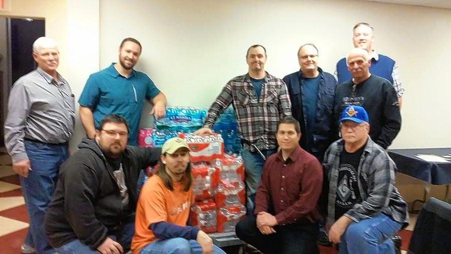 The brethren of D.C. Cregier Masonic Lodge in Wheeling and Constellation Lodge 974, Des Plaines, collected cases of water for shipment to Flint, Michigan.