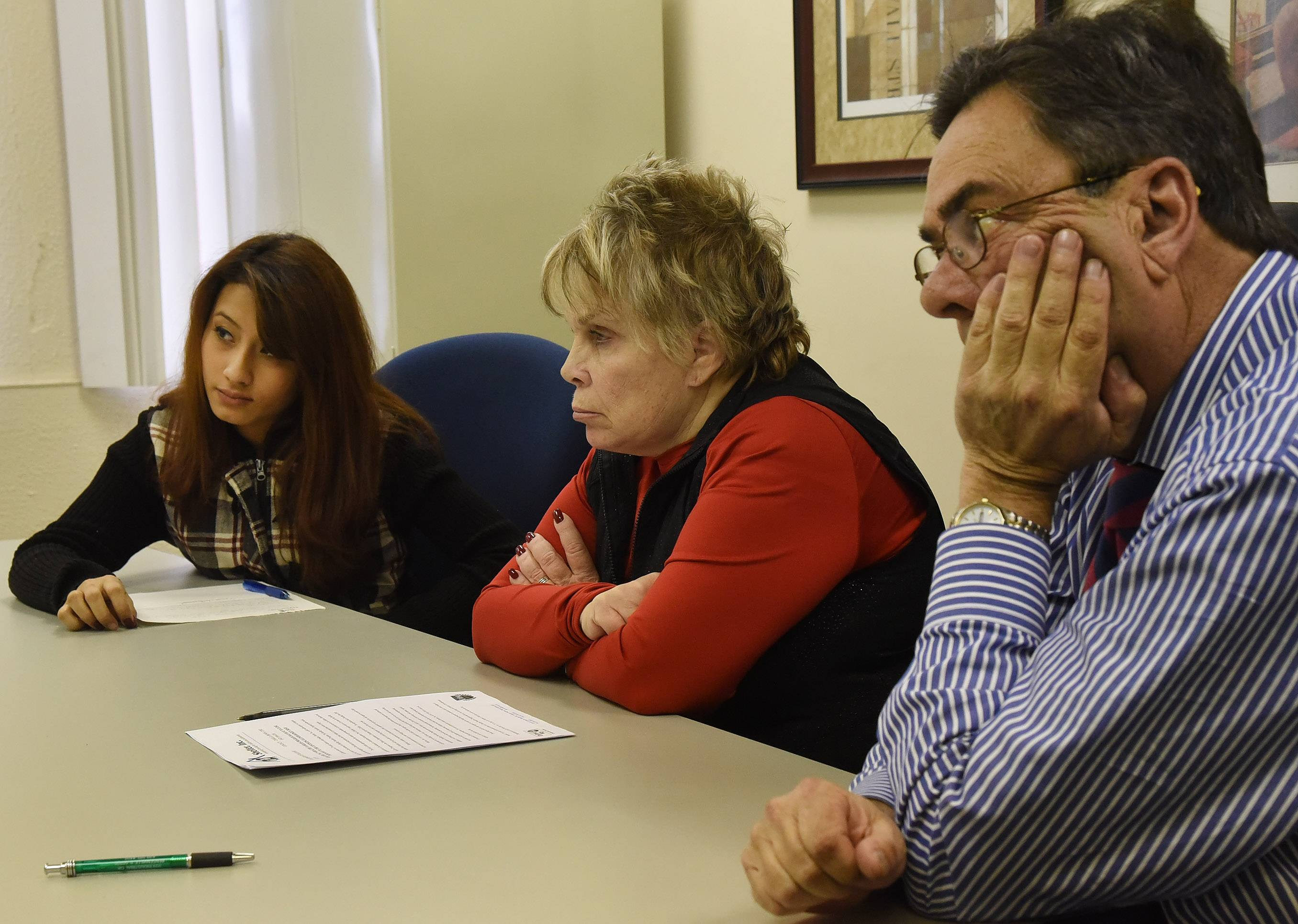 From left, Gloria Jimenez, Shelter Inc.'s director of development Carol Brown, and Shelter Associate Director Tom Eagan.