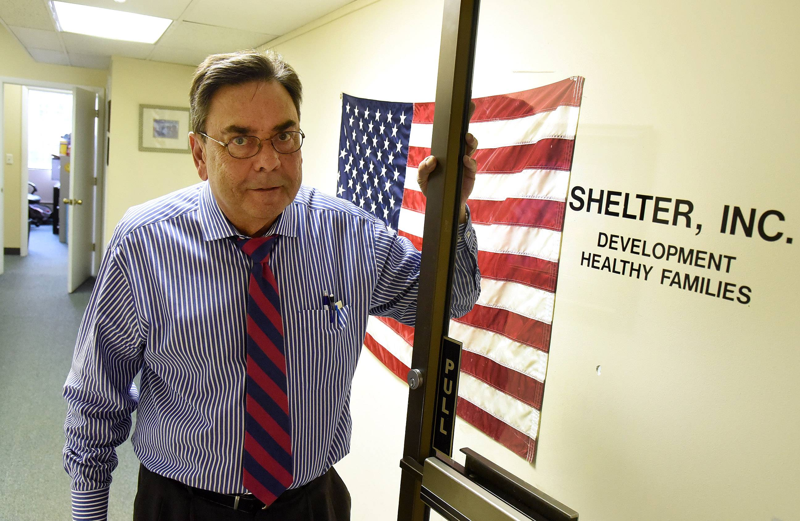 Tom Eagan, associate director of Shelter Inc., in the Arlington Heights office.