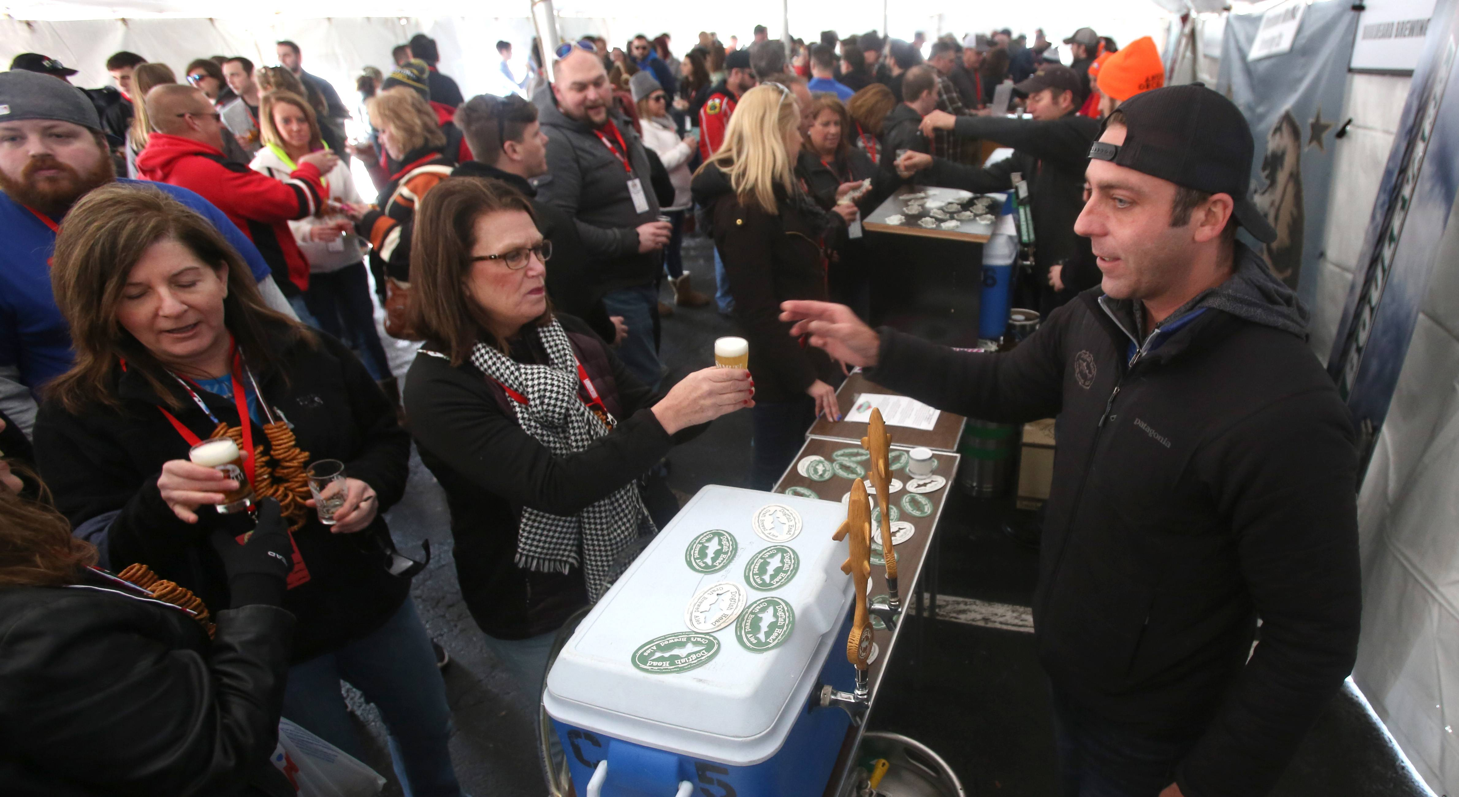 Tim Dunphy pours a sample from the Dogfish Head Brewery, located in Milton, Delaware, during the third annual Naperville Winter Ale Fest at Frontier Park.