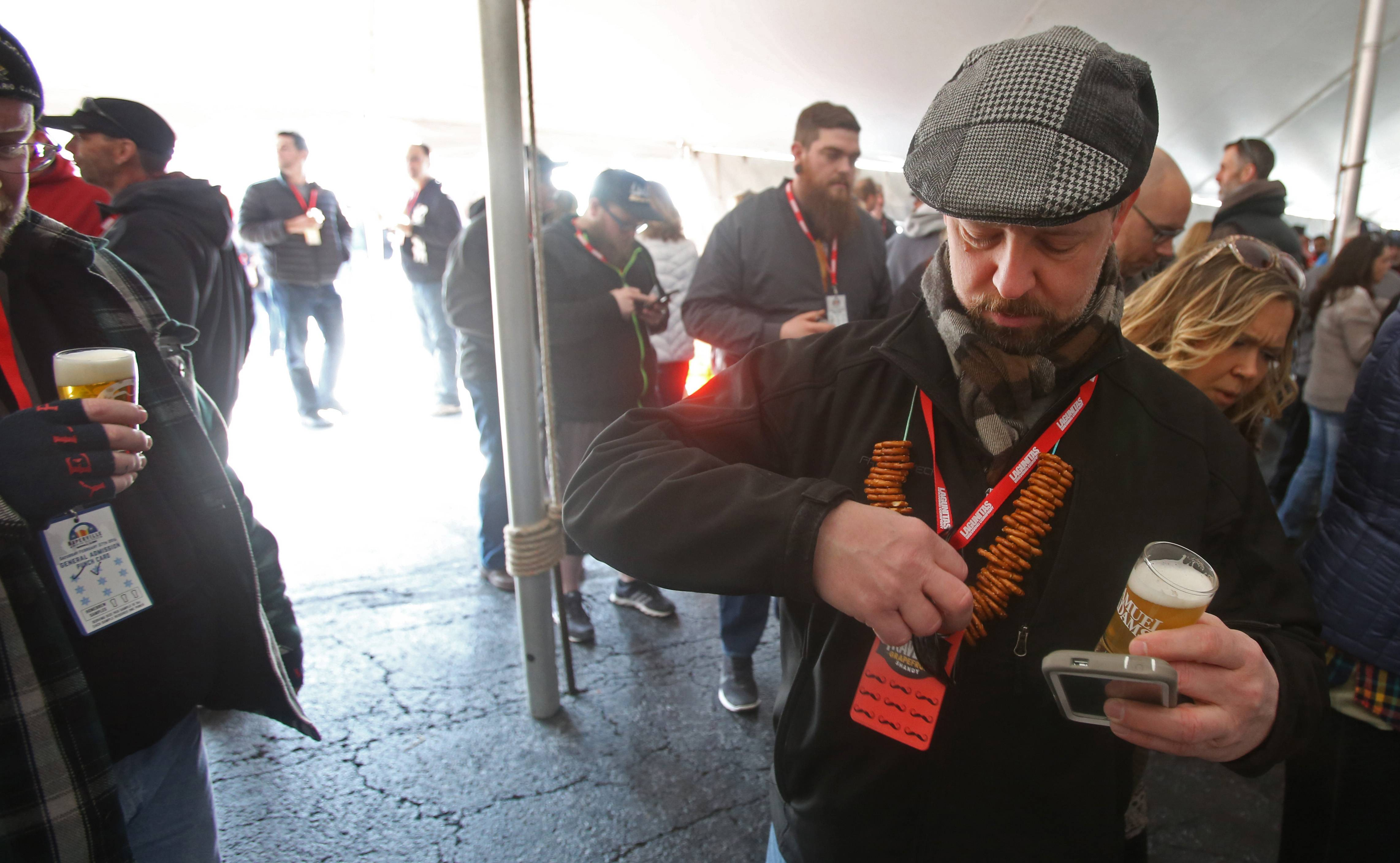 Matt Molitor of Bolingbrook prepares to enjoy a craft beer during the third annual Naperville Winter Ale Fest at Frontier Park.